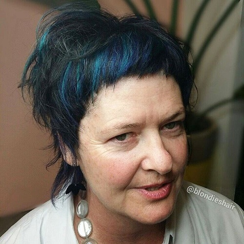 Shaggy Hairstyle With Blue Highlights