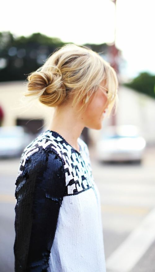messy knot hairstyle with bangs