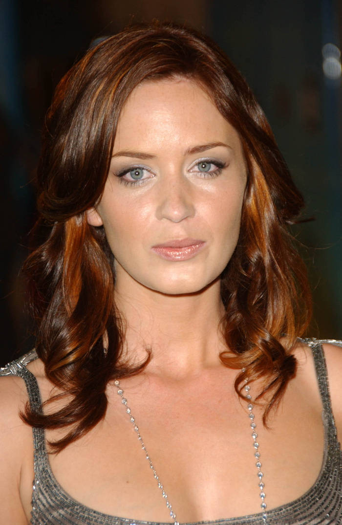 Golden brown hair with red highlights