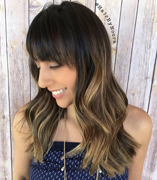 Long Wavy Hairstyle With Straight Bangs