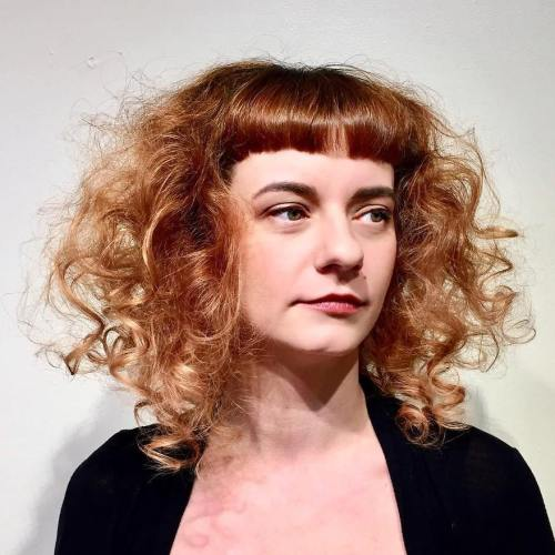 Messy Curly Red Hairstyle With Cropped Bangs