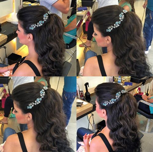 wavy half up hairstyle with jeweled headband