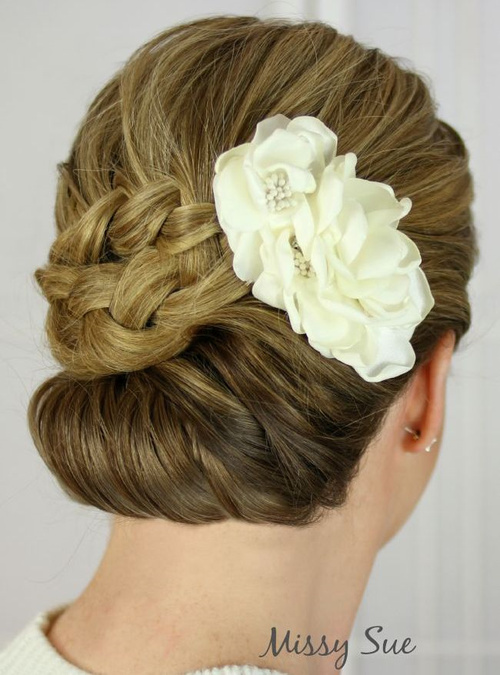 homecoming chignon updo with a flower