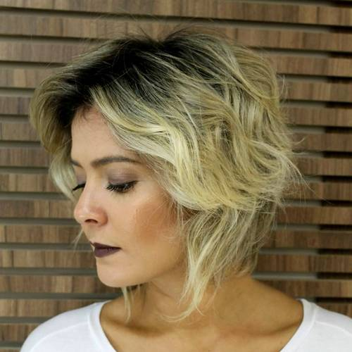 shaggy wavy blonde bob with black roots