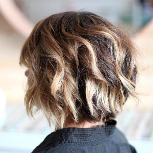 choppy chin-length bob with blonde highlights