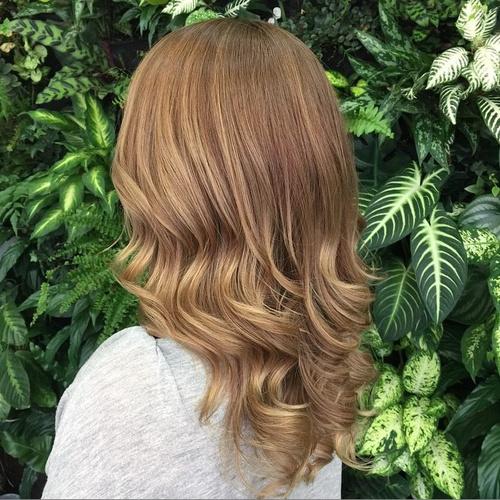 medium layered copper brown haircut