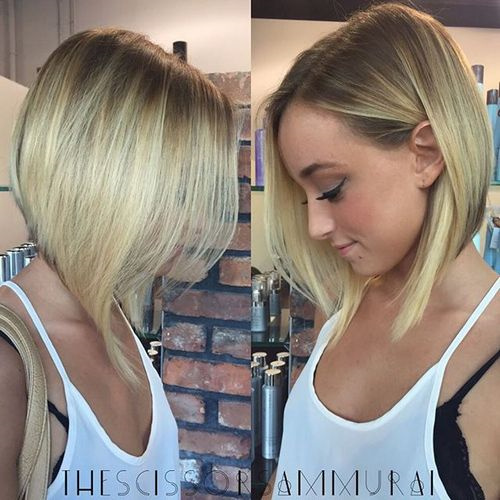 angled blonde bob with dark roots