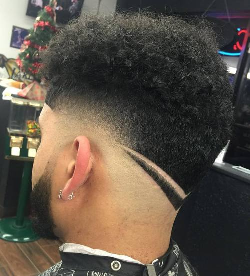 curly top taper fade with nape design