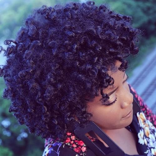 black permed hair of shorter length