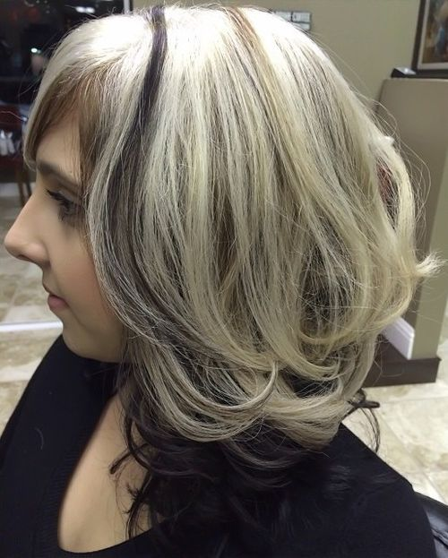 ash blonde hair with dark brown underlayer