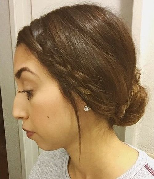 simple low bun with a side braid