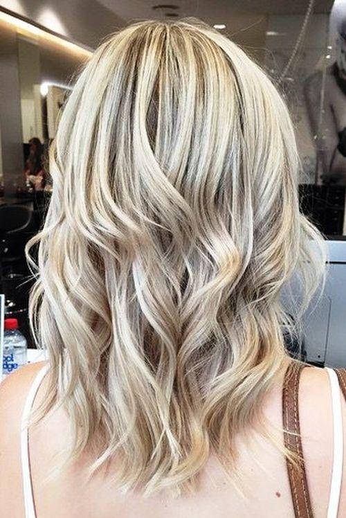 medium wavy brown blonde hairstyle