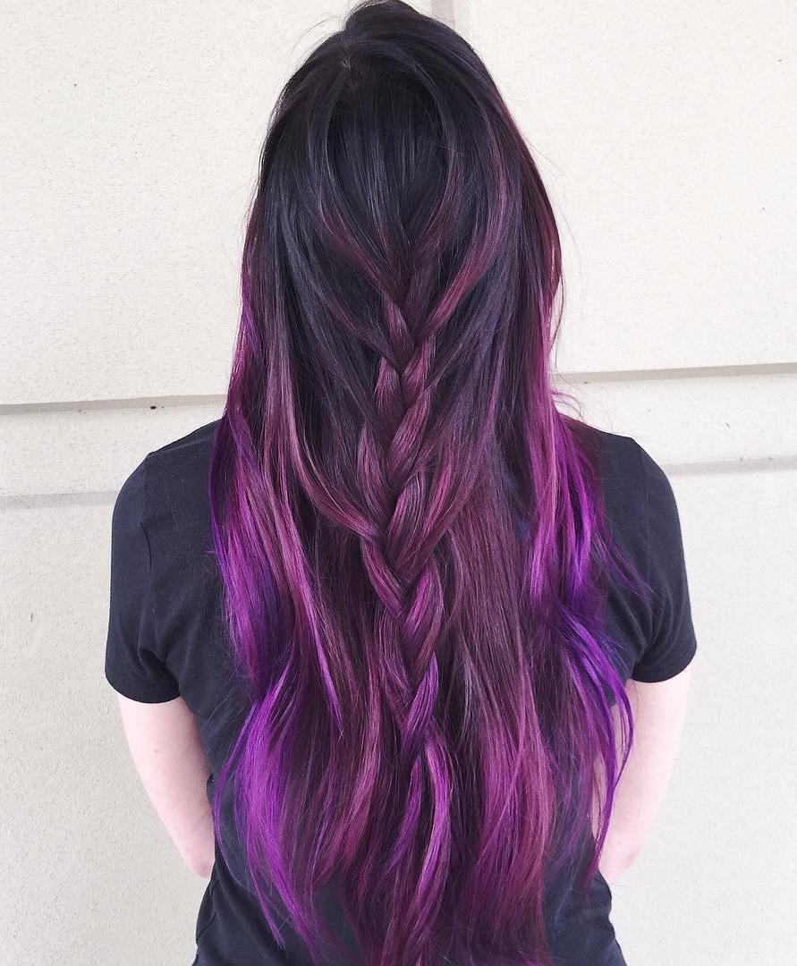 Purple highlights in black curly hair