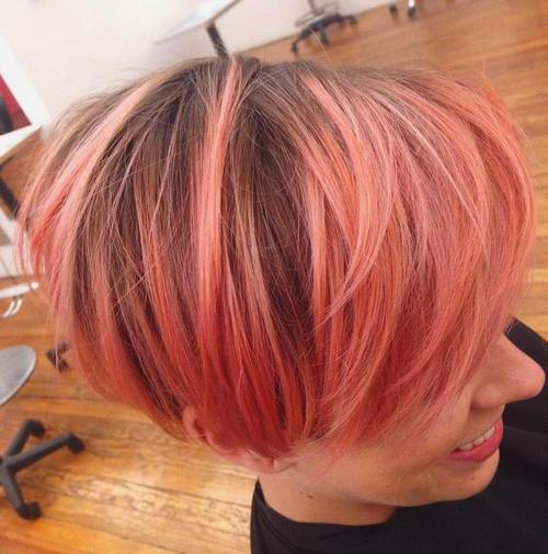coral pink bob with brown roots
