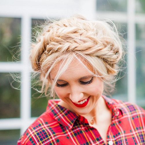 messy Blonde updo with fishtail braids