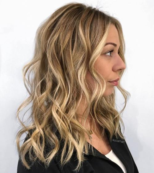 Medium Wavy Honey Blonde Hairstyle