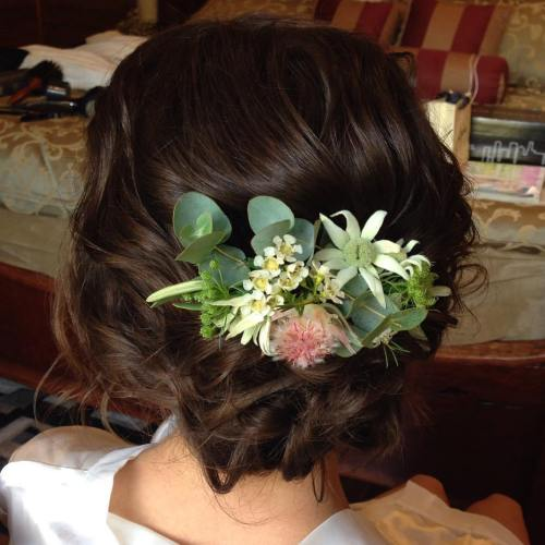 Low Wedding Updo With Exotic Flowers
