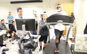 Everett Pratt 21, runs on a tread-mill to test his aerobic fitness performance in a lab.  By Alejandra Flores/ The Runner