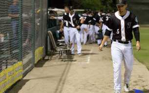 Designated hitter Justin Seager walks out of Sam Lynn Ballpark after a fruitless game against Visalia on Monday, Sept. 12. By Ben Patton/ The Runner