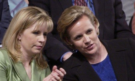 Daughters of Vice President Dick Cheney, Elizabeth, left, and Mary, sit in Madison Square Garden during the Republican National Convention in New York, Wednesday, Sept. 1, 2004. (AP Photo/Charlie Neibergall)