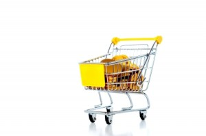 A Shopping Cart Full With Various Groceries implies ways to be saving money
