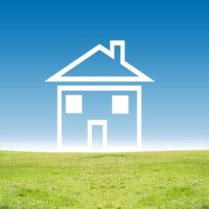House icon on green field can mean saving money can get you to your goals