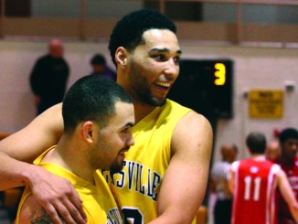 Anthony Coleman and Elijah Obade congratulate each other at center court after the 10-point win over the Raiders.