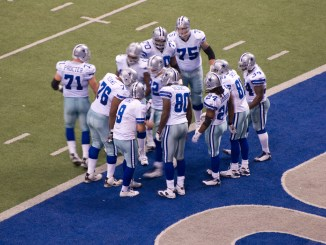 Dallas Cowboys huddle up for a play. Photo courtesy of Wikipedia.