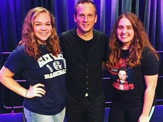 Millersville students Allie Taylor (left) and Christel Booths (right) pose with juggler Nick Pike. (Leanne Seidel/Snapper)