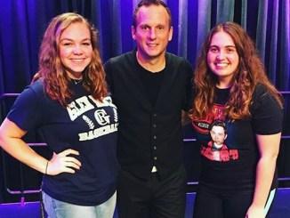 Millersville students Allie Taylor (left) and Christel Booths (right) pose with juggler Nick Pike. (Leanne Seidel/Snapper)