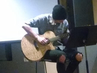 Josh Nein played the guitar at this year's English Club's Caffeine House. (Colin Vandenberg/Snapper)