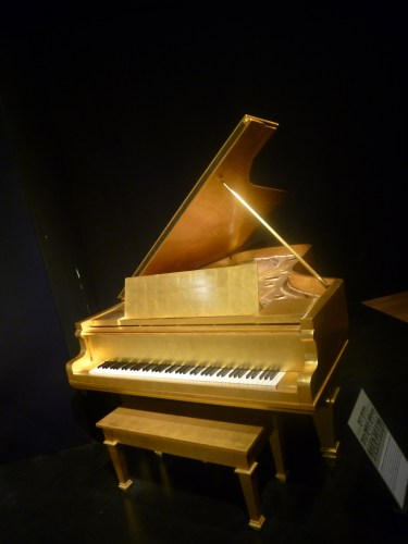 Who doesn't have a shiny gold piano?