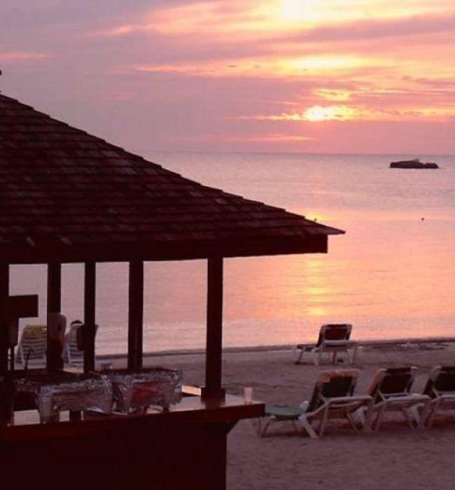 Visit Jamaica: Land I Love. Jerk Hut on the beach in Negril Jamaica.