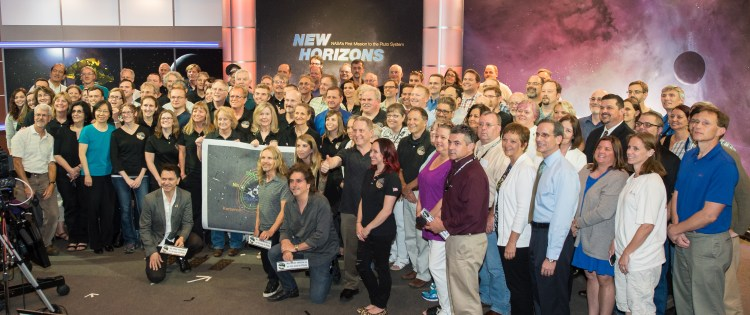 Tommy Shaw, Todd Sucherman and Lawrence Gowen of the band Styx pose for a picture with members of the New Horizons science team, Wednesday, July 1, 2015 at The Johns Hopkins University Applied Physics Laboratory in Laurel, Md.  Members of the band Styx visited with New Horizons team members and Mark Showalter, who discovered Pluto's fifth moon, Styx, in July of 2012.   Photo Credit: (NASA/Joel Kowsky)