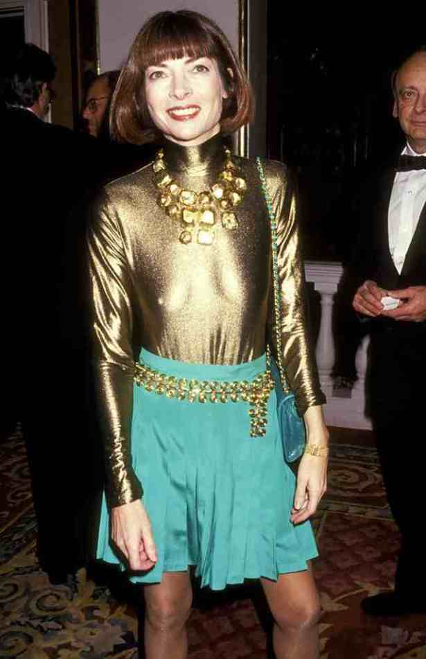 Anna Wintour's metal belt is a classic party accessory. The photo is from 1993, according to Who What Wear.