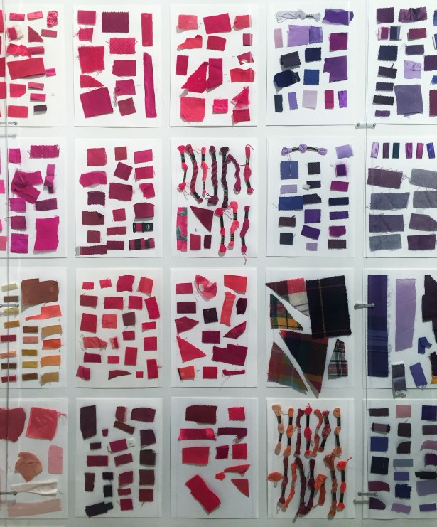The exhibit opens with a wall full of fabric swatches.