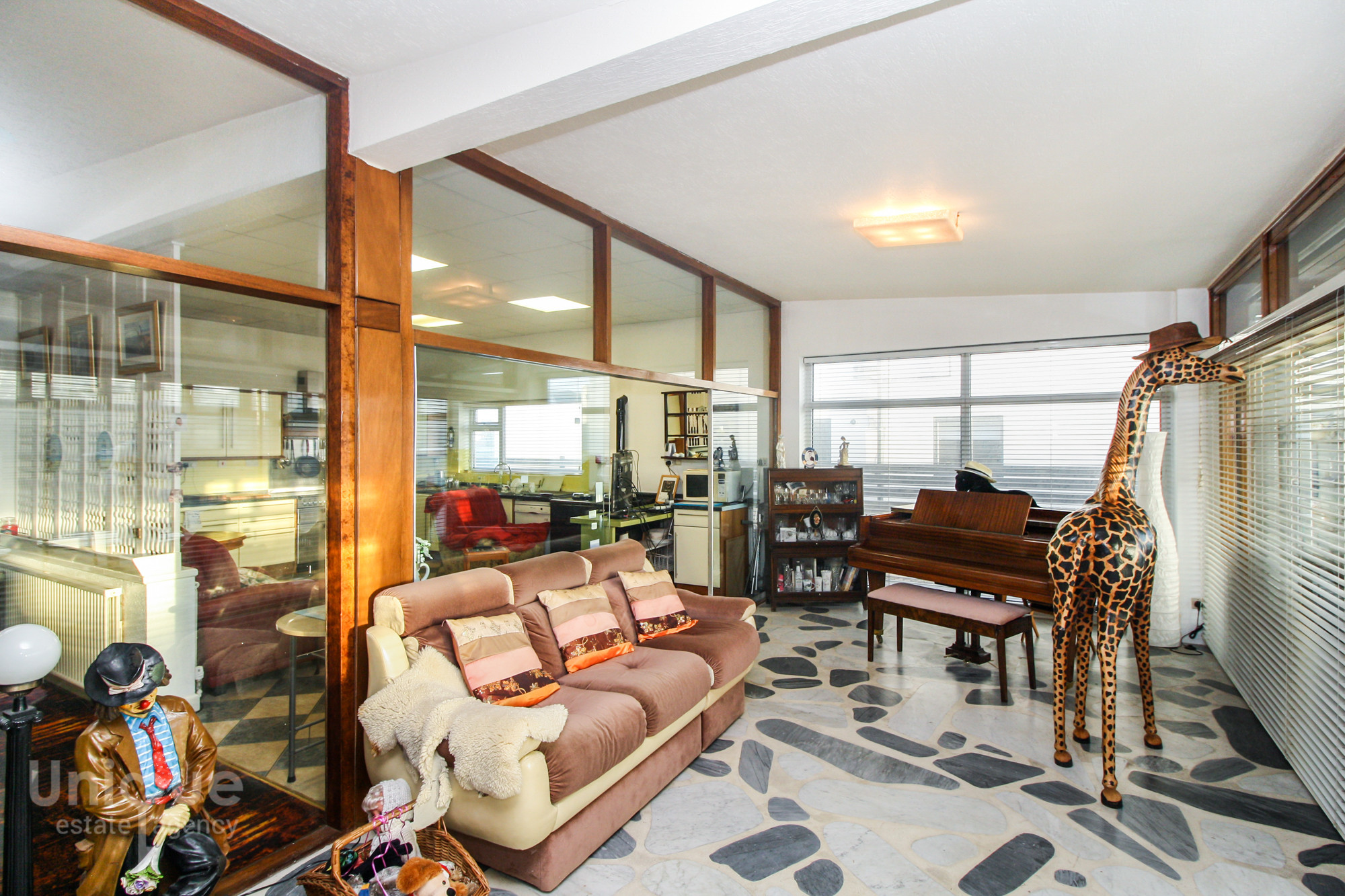 Seafront Bungalow With Eye Watering Charity Shop Las Vegas Interior Including Giant Giraffe Goes On Sale For 600 000
