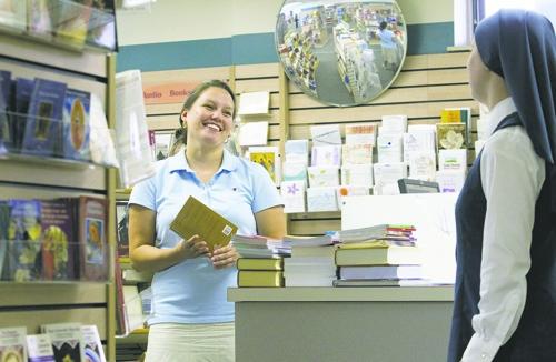 Sales associate Maria Druke talks with Sister Andrew Marie Tyler at - sales associate
