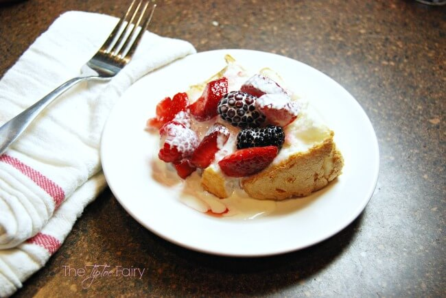 Need a simple dessert? Try this Cream Soaked Berry Angel Food Cake.  Topped with fresh strawberries, blackberries, and raspberries, and then drizzled with whipping cream for an easy yet elegant dessert. | The TipToe Fairy