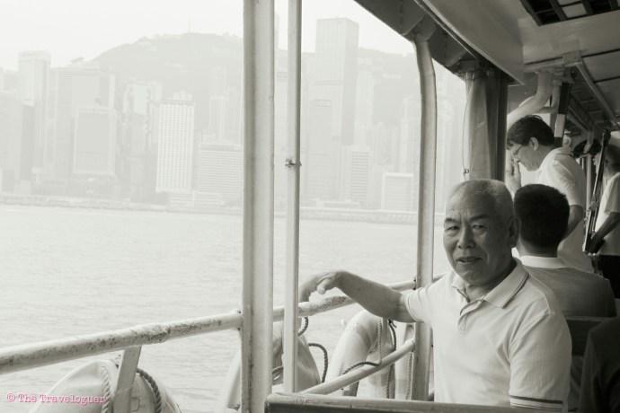 man on hong kong's star ferry at Tsim Sha Tsui,