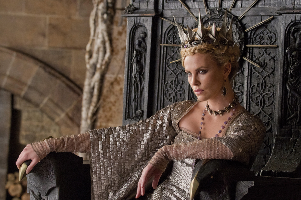 "Charlize Theron stars as the evil Queen Ravenna in the latest adaptation of the classic fairytale ""Snow White"" titled ""Snow White and the Huntsman."""