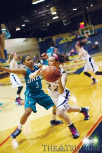 Freshman shooting guard Meghan Creighton is guarded closely by a UNCW defender in the Dragons' 59-47 victory over the Seahawks Feb. 19 at the DAC.