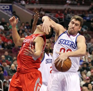 Spencer Hawes of the Philadelphia 76ers steals the ball from Jeremy Lin of the Houston Rockets during the fourth quarter at the Wells Fargo Center in Philadelphia on Nov. 13. The Sixers won in overtime, 123-117.