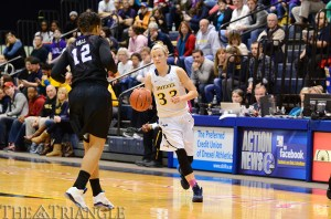 Senior Fiona Flanagan (right) scored nine points on 3-4 shooting and dished out five assists in Wednesday's Senior Night win over Towson University March 5 at the DAC. It was the women's basketball team's final game of the regular season.