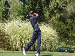 Freshman golfer Yoseph Dance watches a shot at the Cornell Invitational September 22. Dance finished tied for 25th at the Navy Spring Invitational April 20.