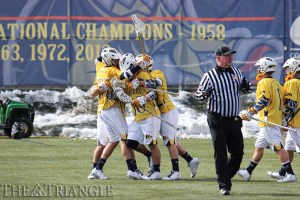 The men's lacrosse team celebrates scoring a goal against Robert Morris University March 1. The Dragons won that game, 18-12, and have won seven of their last nine since that afternoon to clinch the No. 2 seed in the Colonial Athletic Association tournament. The team concludes the regular season April 25 at High Point University.