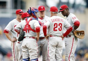 Philadelphia Phillies manager Ryne Sandberg (23) talks with relief pitcher Jake Diekman (middle) and the Phillies infield against the Pittsburgh Pirates during the eighth inning at PNC Park. The Pirates won 6-2. (Charles LeClaire - USA Today Sports)