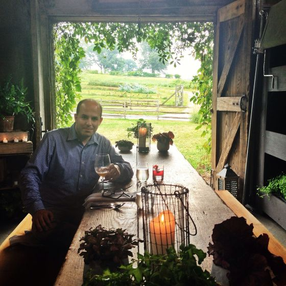 brian in outdoor farmhouse at blue hill stone barns