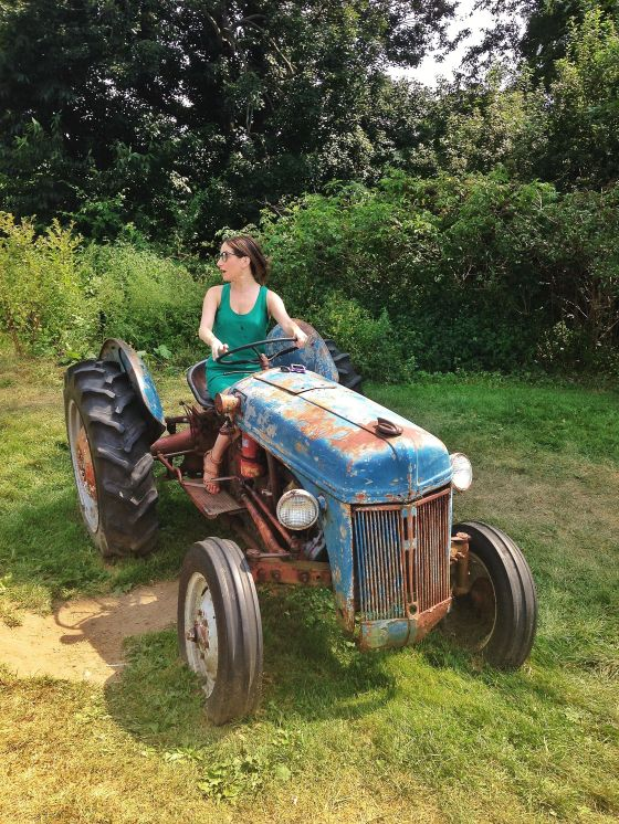 me on a tractor, stone barns