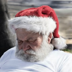 Admit that without the red suit he looks a lot like the guy you see asleep on the downtown A Train.   Photocredit: Flickr/Elido Turco
